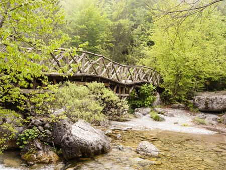 olympus: Wooden bridge over a river in the mountains of Olympus at Greece