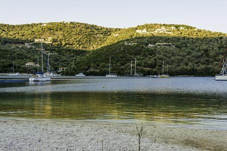 tourist resort: Lefkada island, Greece - August 27 2016: Sivota village tourist resort in Lefkada Greece with sailing ships Editorial