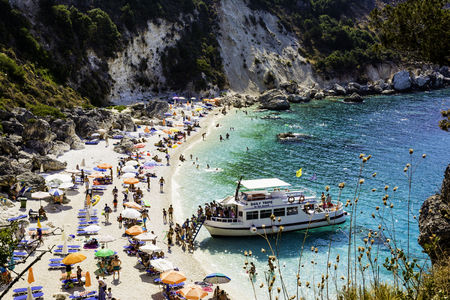 ionian: EDITORIAL: LEFKADA ISLAND, AGIOFILLI BEACH, 29 AUGUST 2016, GREECE - summer holidays, many people on the beach, sea swimming Editorial
