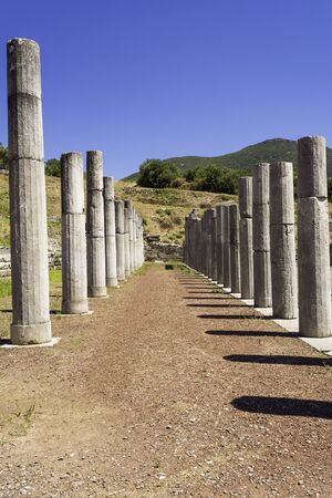 Pillar ruins of the ancient Greek city of Messinia at Peloponnese, Greece Stock Photo