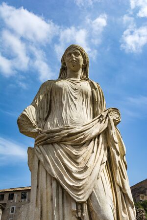 Roman statue at House of the Vestals in Roman Forum , Rome, Italy.