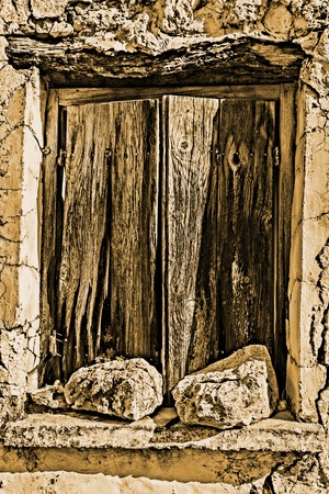 Old wodden window shutter of traditional house in the village Chamaitoulo, Crete, Greece. Stock Photo
