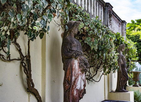 Achilleion palace, Corfu, Greece - August 24, 2018: Statues in the courtyard of Achilleion palace of Empress of Austria Elisabeth of Bavaria. Editorial