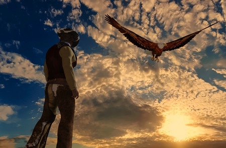 Illustration of a cowboy at sunset background with an eagle - 3D rendering