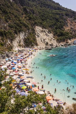 Lefkada island, Agiofilli beach, Greece. Summer holidays, many people on the beach, sea swimming