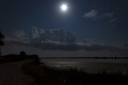 Night scenery. Full moon over lake at Corfu. Greece. Imagens