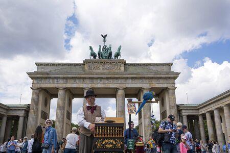 People visit Brandenburg Gate in Berlin