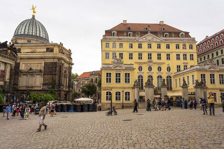 Dresden, Germany - August 15, 2019: View from Frauenkirche towards An der Frauenkirche Street with Academy of Fine Arts in Dresden, Germany.