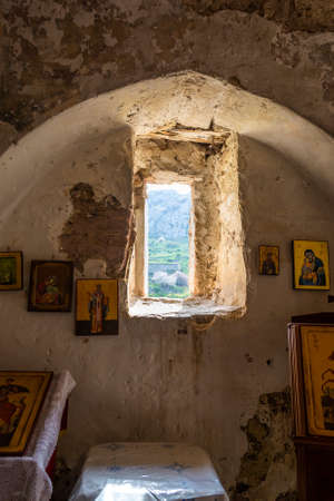 Stoned church interior in the ruins of Acrocorinth ancient ruined fortress on a sunny day..