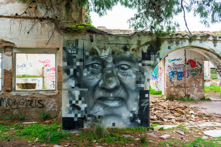 Abstract face wall painting at an abandoned old villa at Pallini, Greece