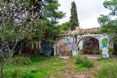 Villa Levidi, Pallini, Greece - February 14, 2021: Abstract face wall painting at an abandoned old villa at Pallini, Greece