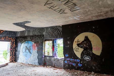 Villa Levidi, Pallini, Greece - February 14, 2021: Dog wall painting at an abandoned old villa at Pallini, Greece