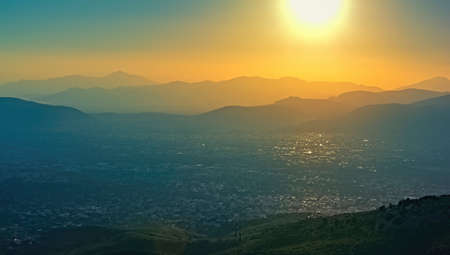 Panoramic view over Athens, taken shot from Penteli mountain at sunset.