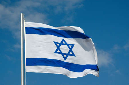 The blue and white national flag of Israel blowing in the wind  Stock Photo