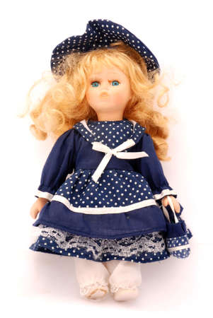 An old toy for female kids, a vintage porcelain doll in a blue dress, isolated on white background