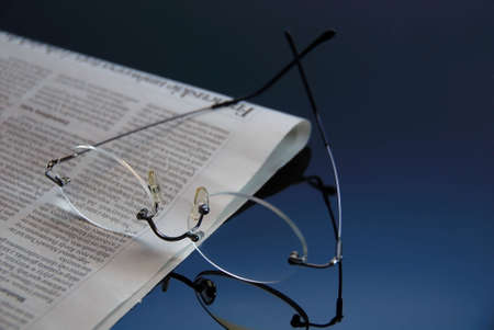 glasses on the glass with the newspaper