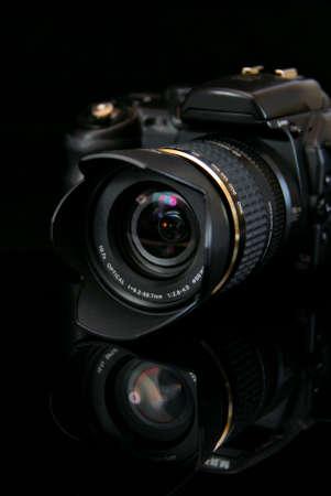 modern profesionalny camera SLR on the black background