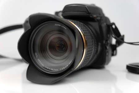 modern profesionalny camera SLR on the white background
