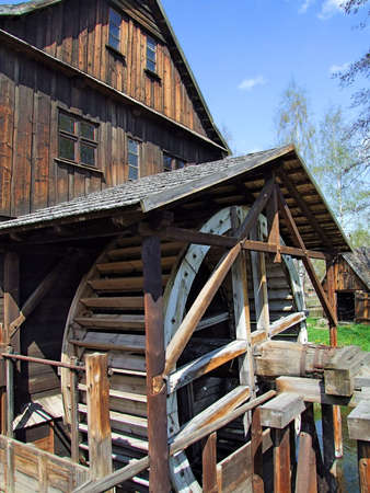 restored: An old mill with water wheel in Poland