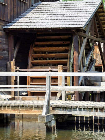 grist: An old mill with water wheel in Poland