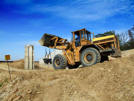 Front loader unloading concrete rubble on urban construction site Stock Photo