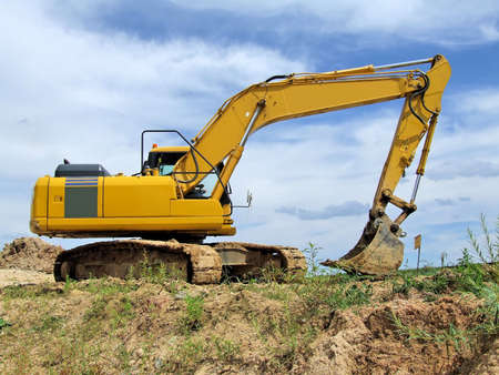 Yellow excavator at construction site Stock Photo - 2834022