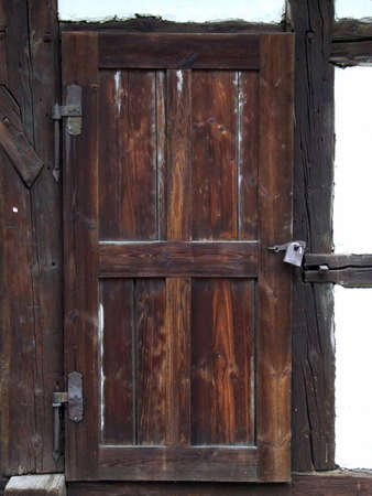 the old wooden door in the country hut Stock Photo