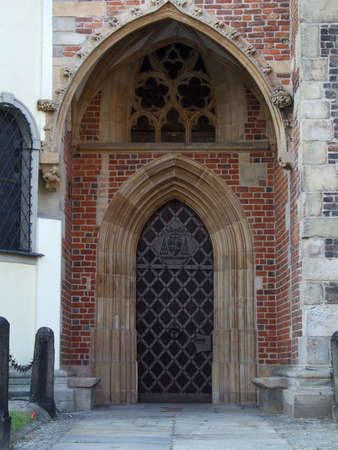 The closed arched doorway of a Church photo