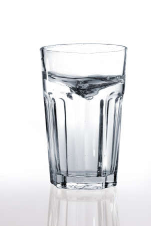 A glass of water on a reflective surface Stock Photo