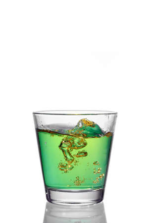 drink splash at the top of a glass Stock Photo