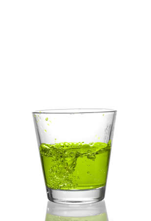 thirsting: drink splash at the top of a glass Stock Photo