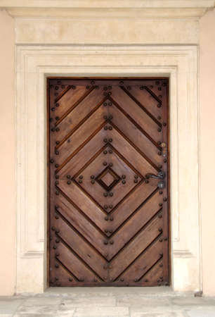 Door of a building in castle, Poland photo
