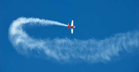 Acrobatic plane in action. Stock Photo