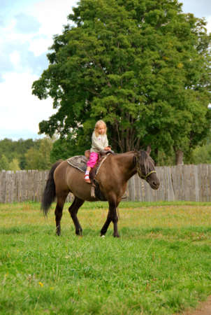 little girls on the horse Stock Photo - 4979038