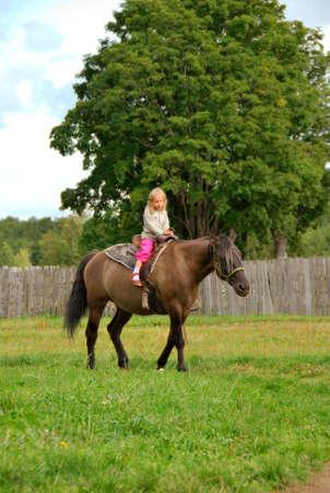 little girls on the horse Stock Photo - 4979038