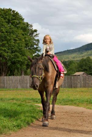 little girl on the horse Stock Photo - 4979039