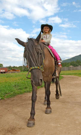 little girl on the horse Stock Photo - 4979032