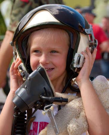 young girl in the pilot helmet