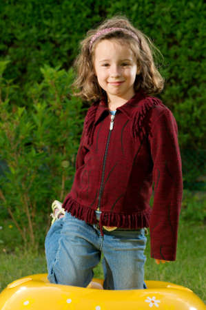 kneel down: smiling young girl