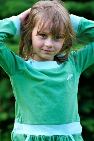 Young girl in green blouse Stock Photo - 5090044