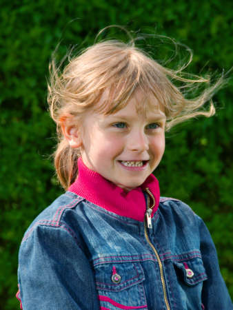 Young girl in jeans jacket photo
