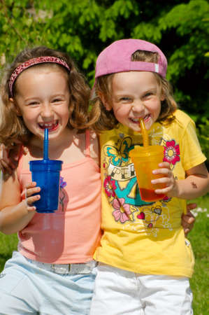 Young girls drink lemonade Stock Photo