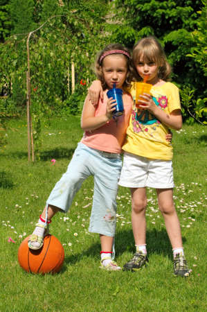 drinking straw: Young girls drink lemonade Stock Photo