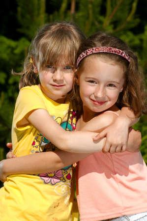 Two friends in hugs