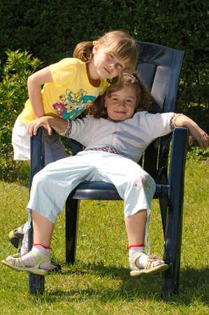 girl bonding: Two girls in the garden