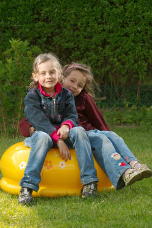 Two girls sitting in the garden