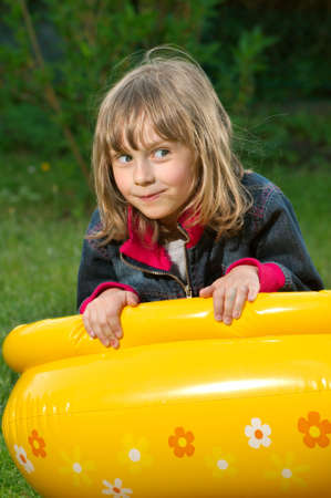 young girl lies on the blown toy Stock Photo