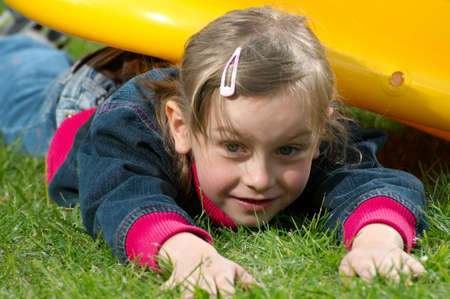 young girl lies on the grass