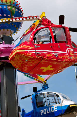 Carousel with helicopters Stock Photo