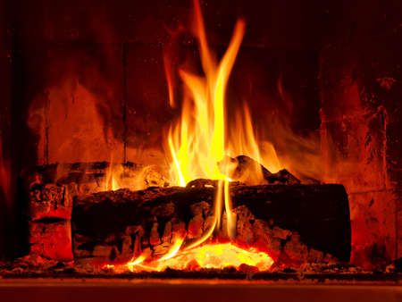 Fire burning in fireplace Stock Photo
